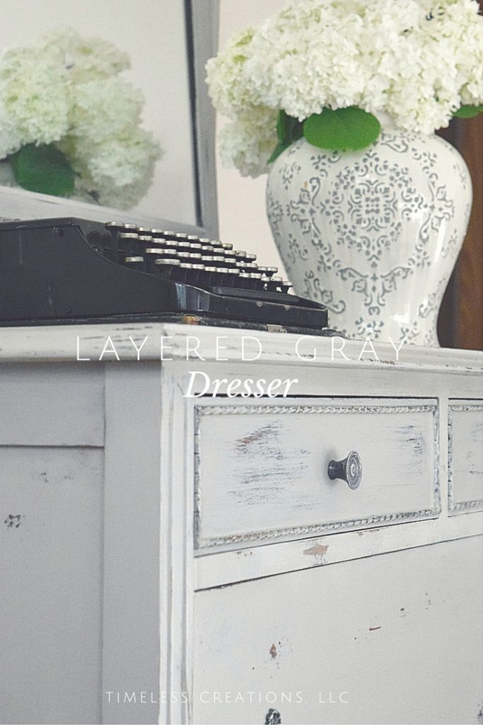 Layering paint to get a multi-colored distressed look on a dresser-Timeless Creations, LLC