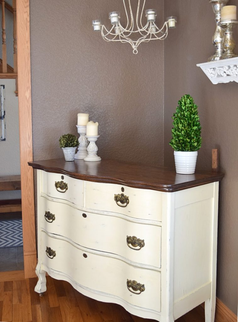but just look how lovely the piece turned out we ended up making inserts for the drawers with fabric and again used the original hardware which just added